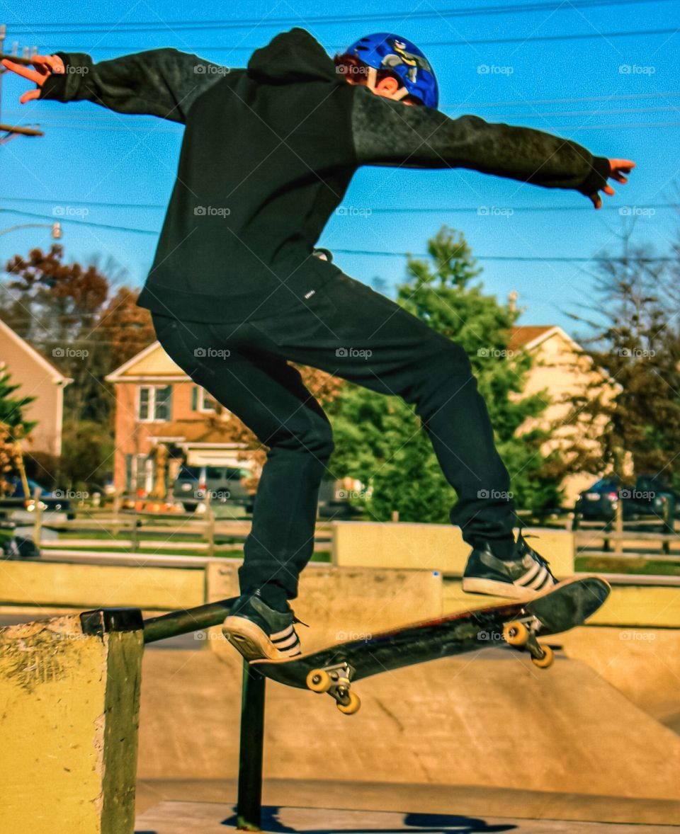 Boy on a skateboard doing a trick.