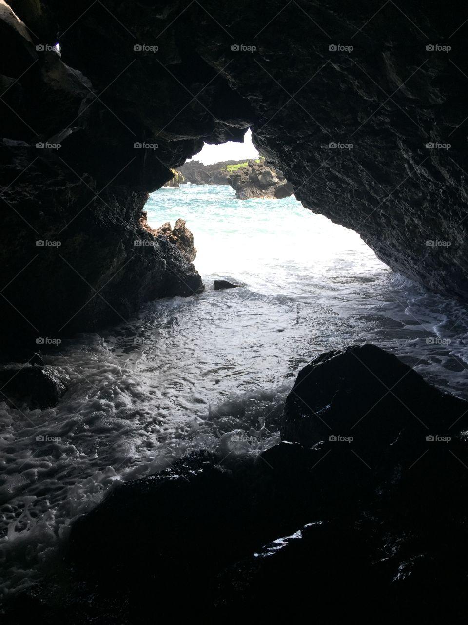 Hana cave black beach