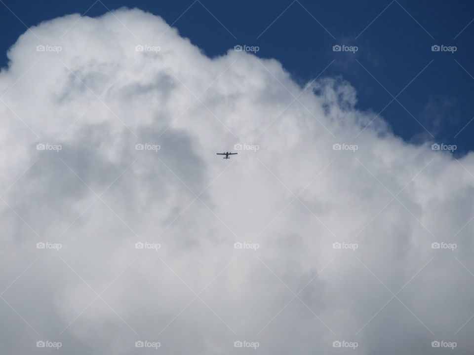 Airplane in front of a cloud
