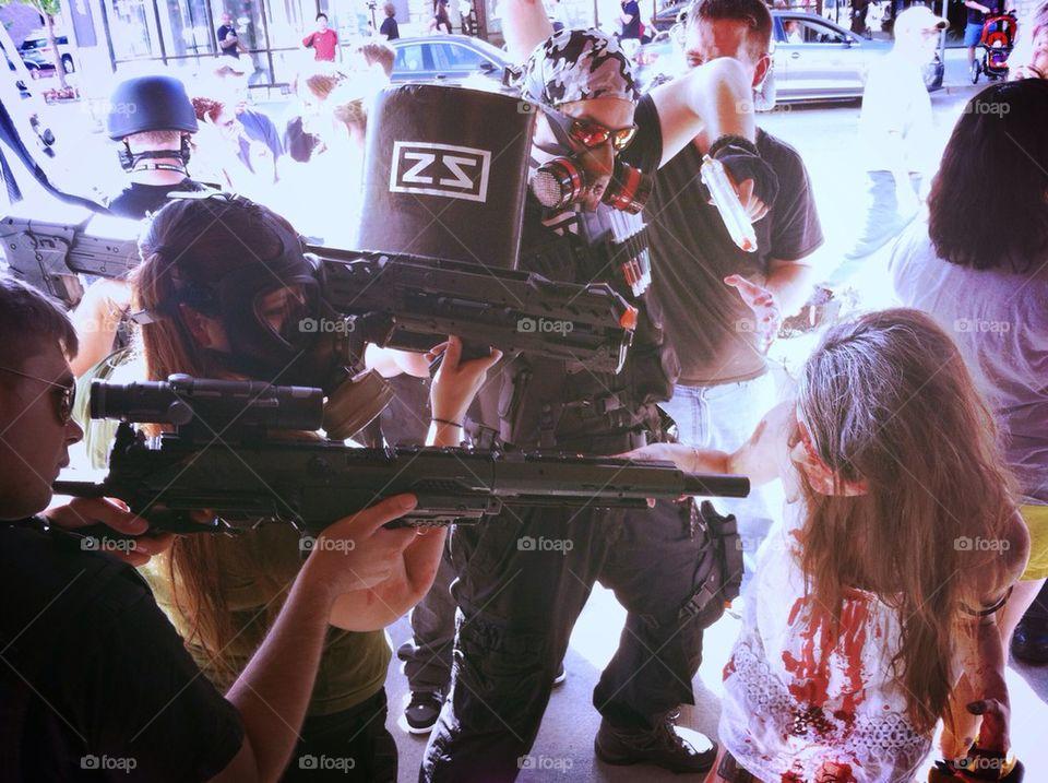 The Zombie Squad corners a zombie.