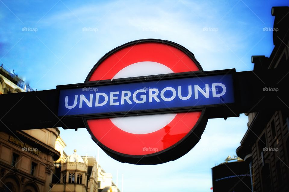 A London Underground illuminated sign.