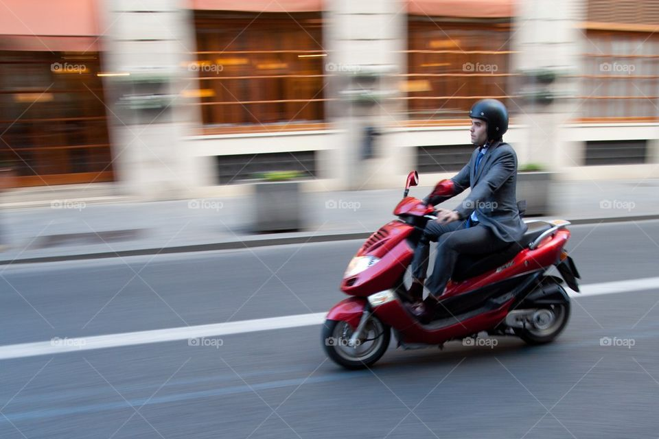 Business man on scooter.