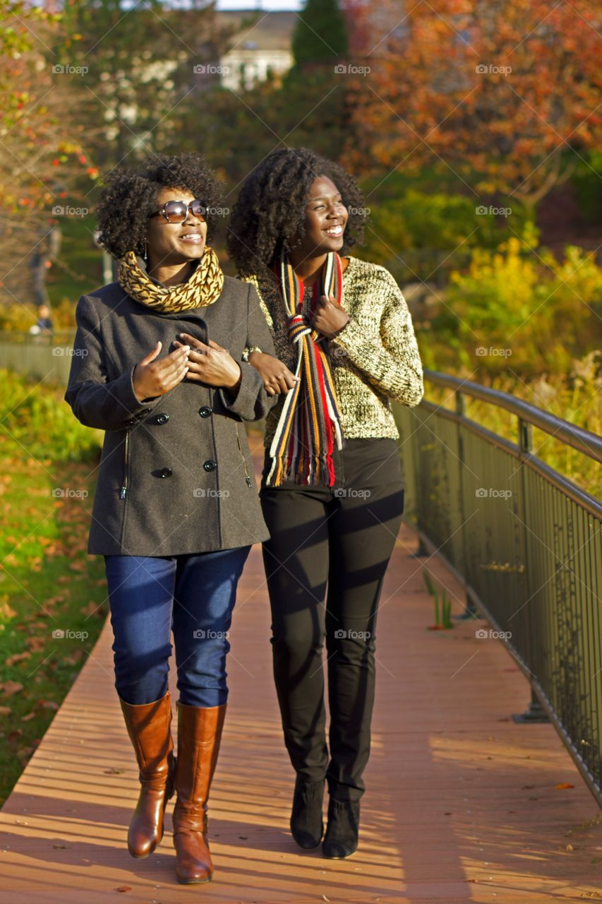 Ladies on a Walk. Ladies enjoy a walk in the park on a fall day.