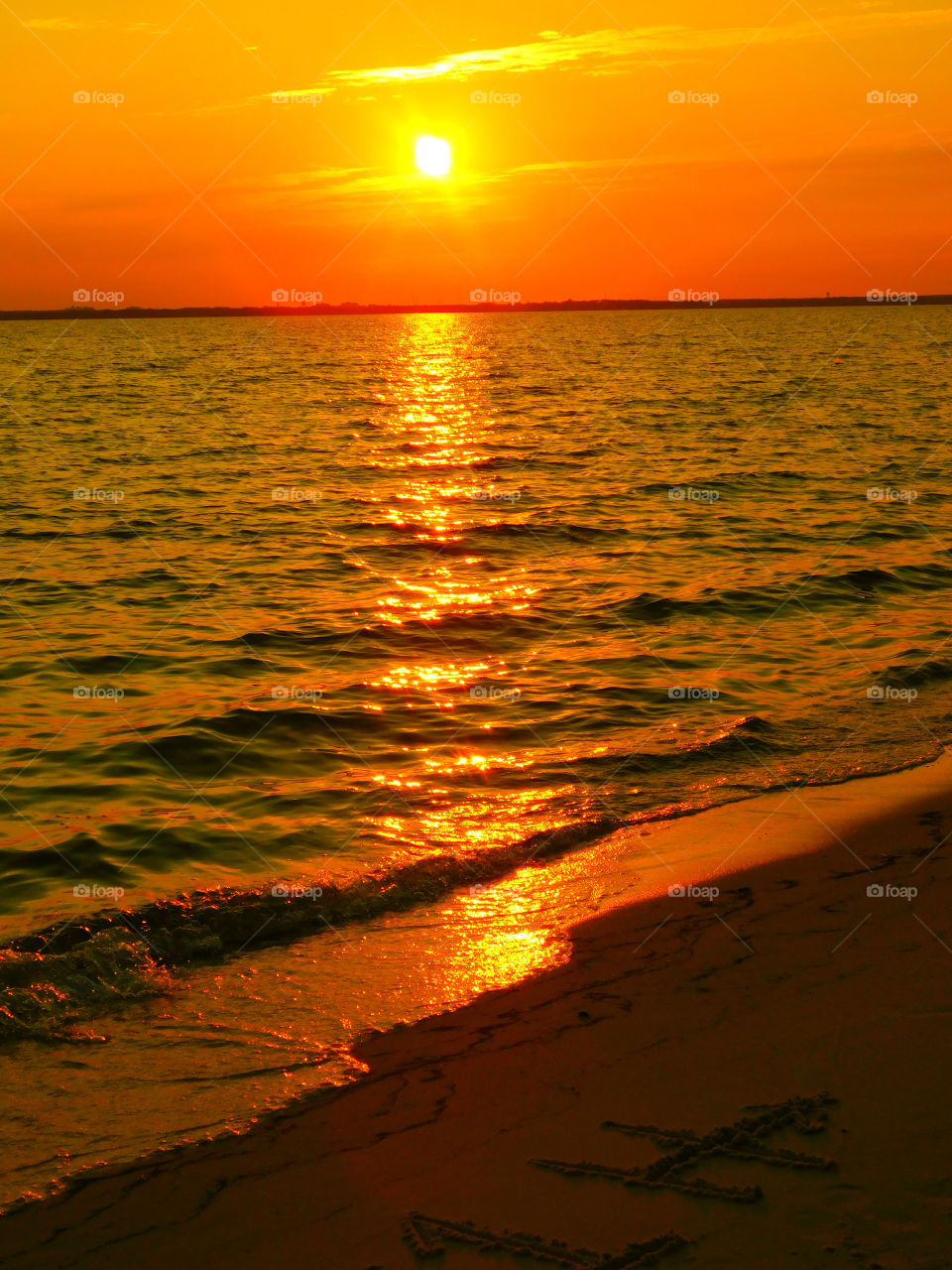 The sky was filled with the most brilliant orange complimented perfectly with hues of gold, yellow, red and crimson. An orange haze had casted over the water, reflecting off every wave.  Finally,the sun disappears along with the shine. I can only wait to see another magical moment of beauty and warmth! I can only wait for another sunset! Enjoy!