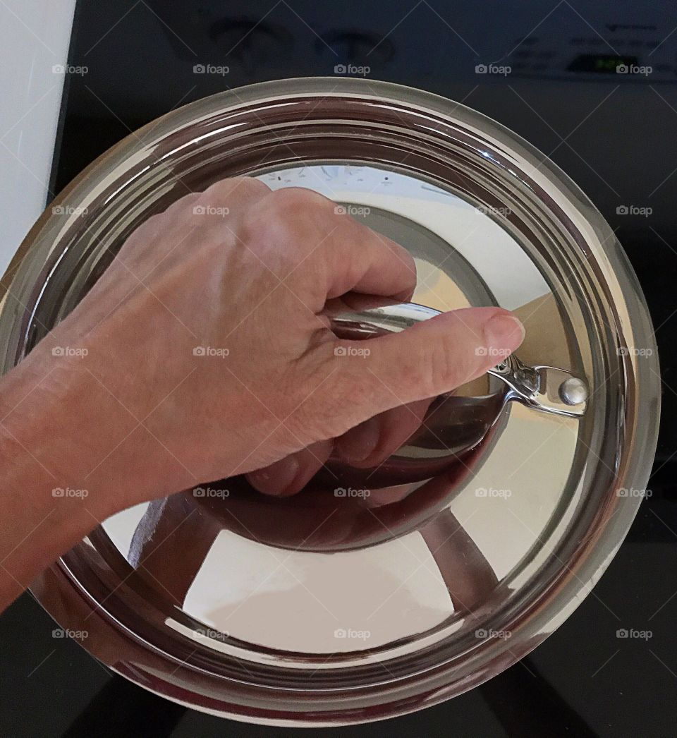 Close-up of person's hand holding cooking pan