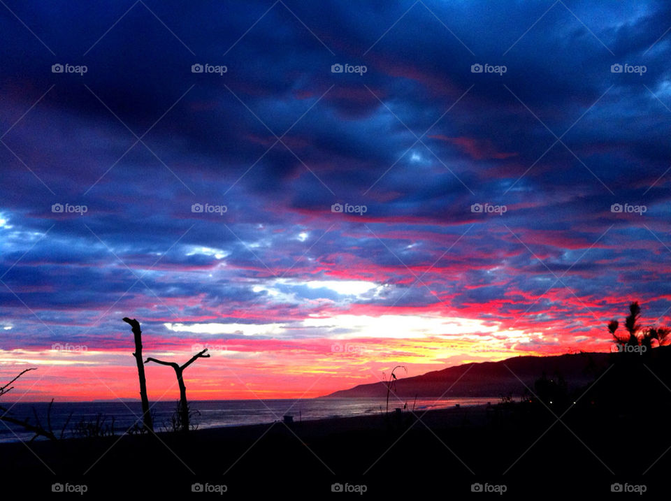 beach sky sunset clouds by chadkanera