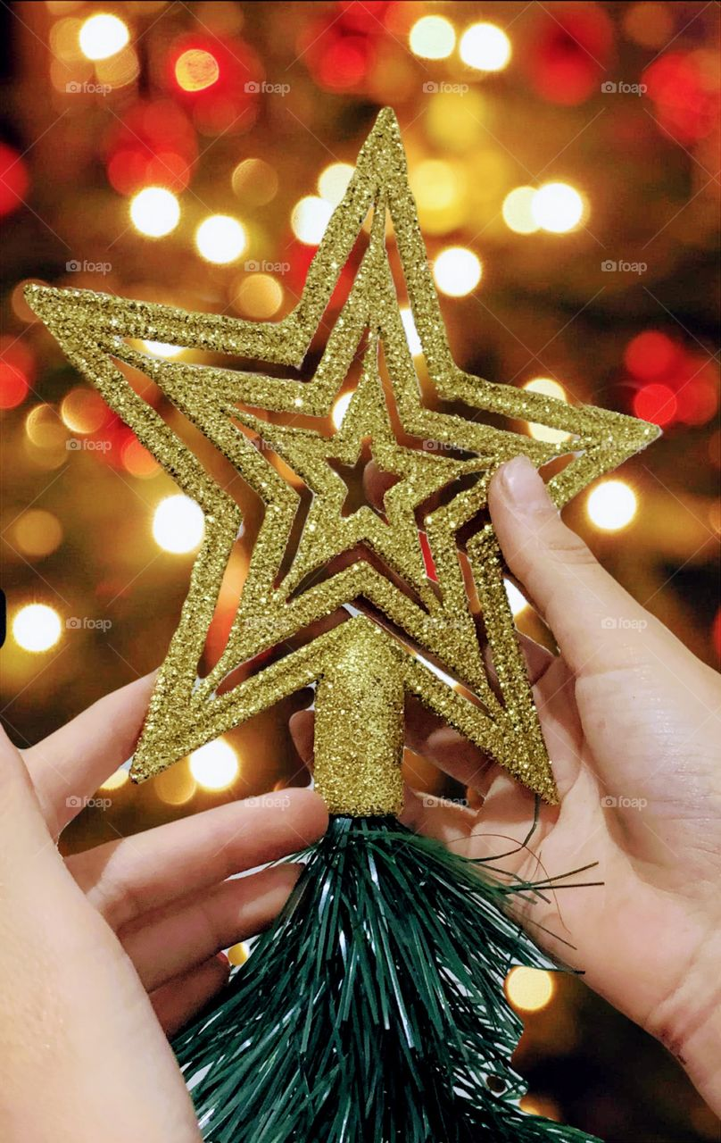 Golden star on top of the christmas tree