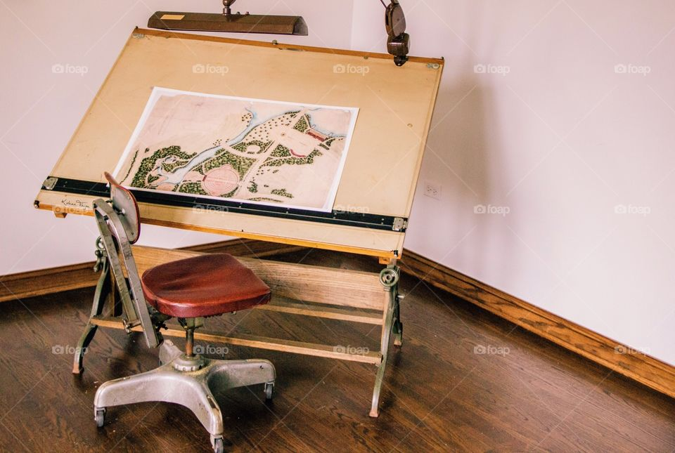 A still of a map and desk.