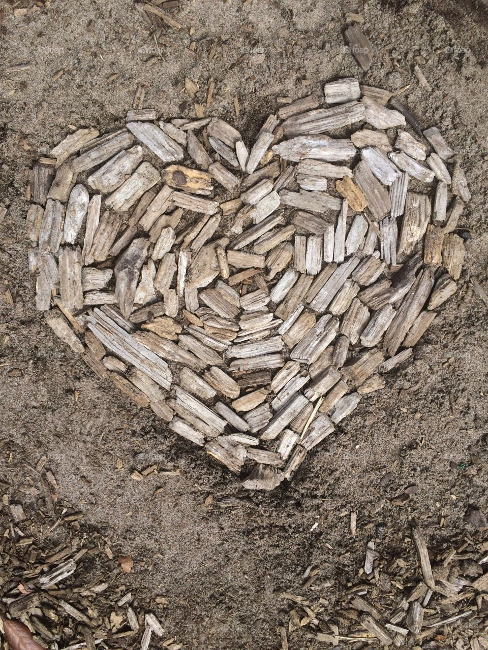 Michaelangelo have seen great heroes hidden in the white blocks of stone brought to him. A builder sees a magnificent house in the heap of materials on a construction site. What did you see in the wood chips scattered on a playground? A happy story, I hope.