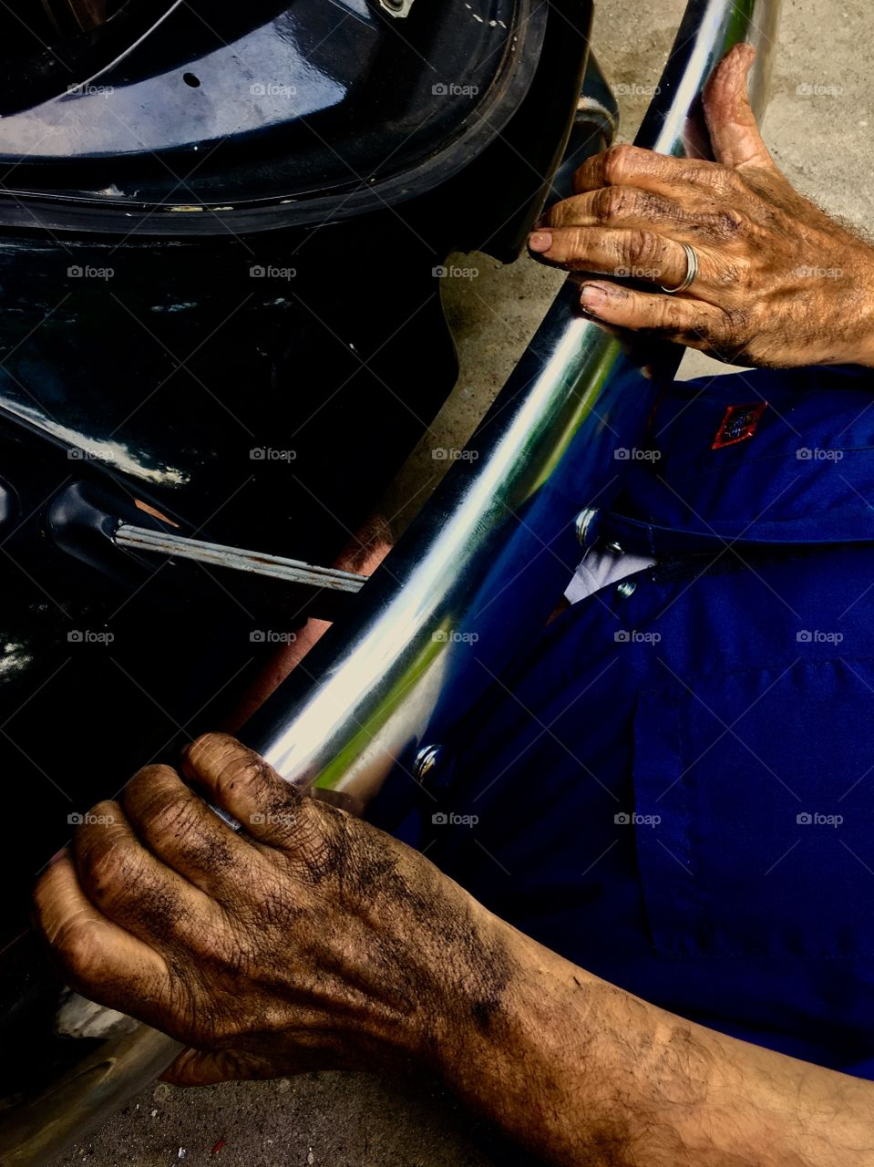 A person repairing a vehicle