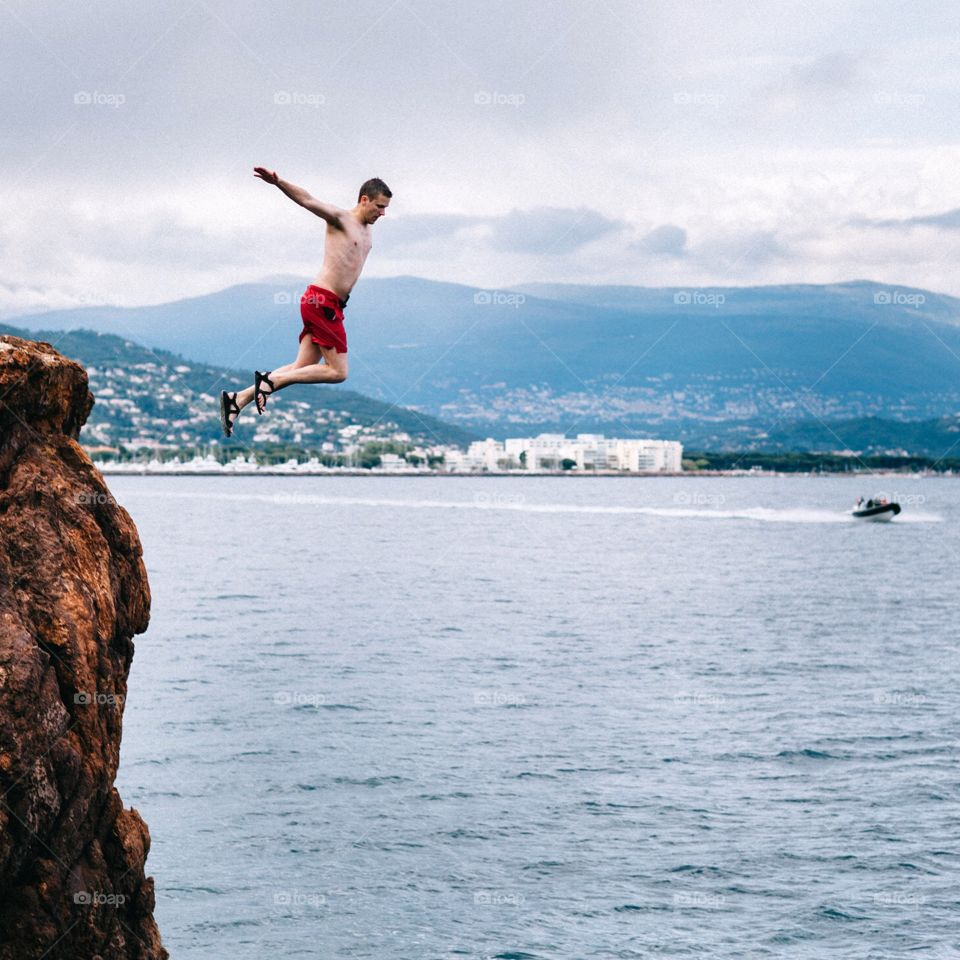 Cliff jumping in the French Riviera into the Mediterranean Sea. Cliff diving jumping into the Mediterranean Sea.