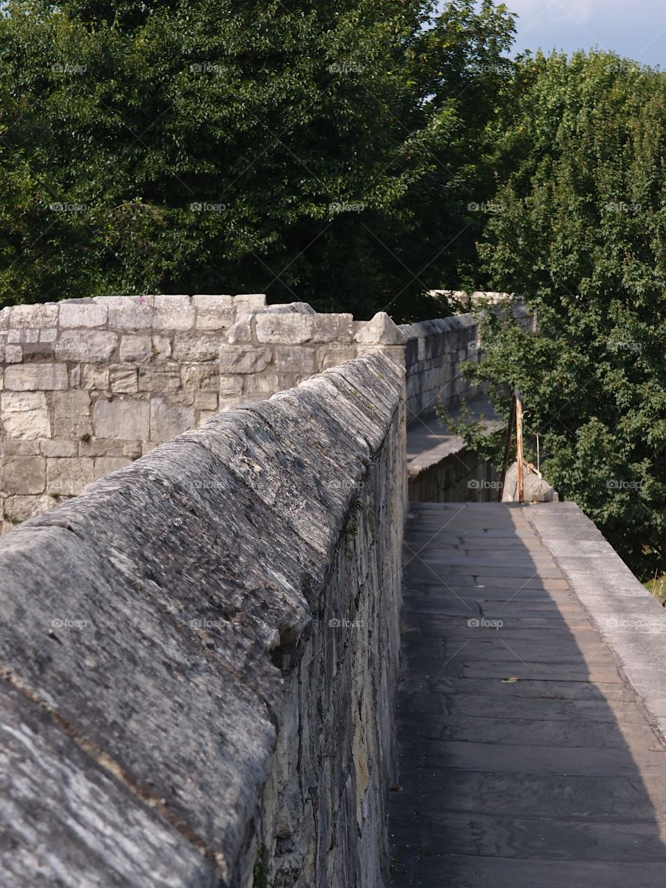 The historic fortified York Wall made of massive stone and a nice walkway surround the older parts of the city.