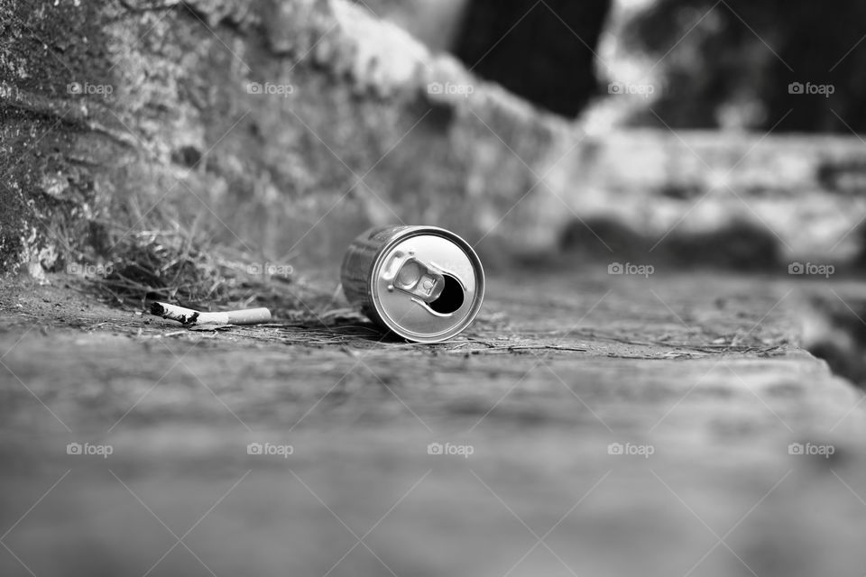 metal can on the ground garbage