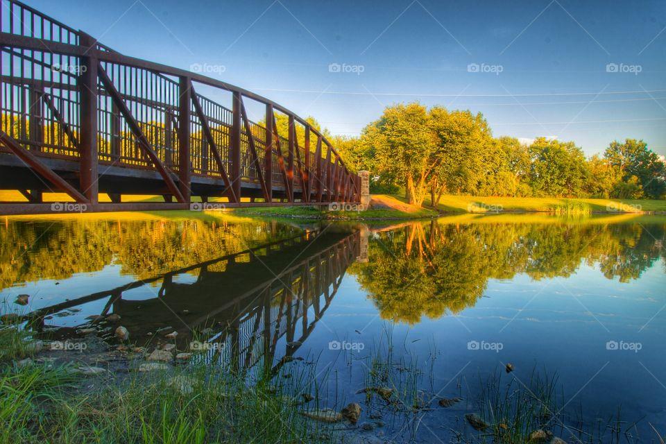 Bridge over calm lake
