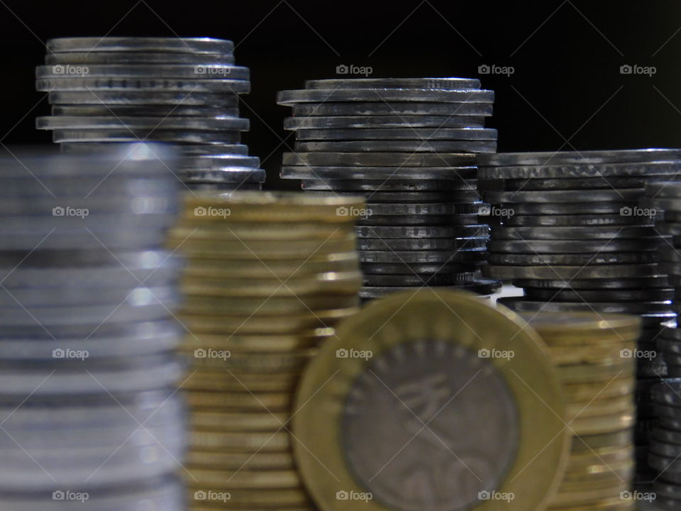 Indian Currency in Rupees - Coins are stacked with definite arrangement.
