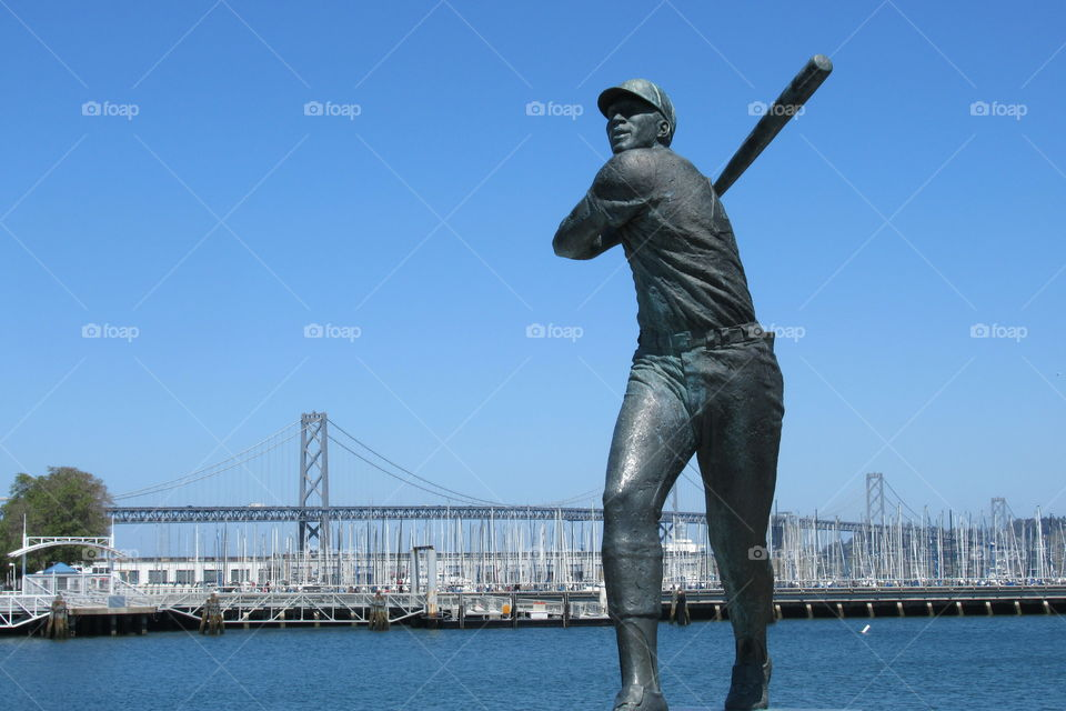 Willie McCovey with Bay Bridge in background