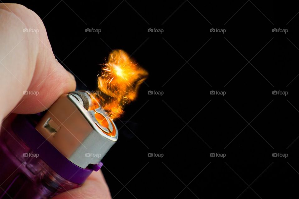 Close-up of lighter with fire