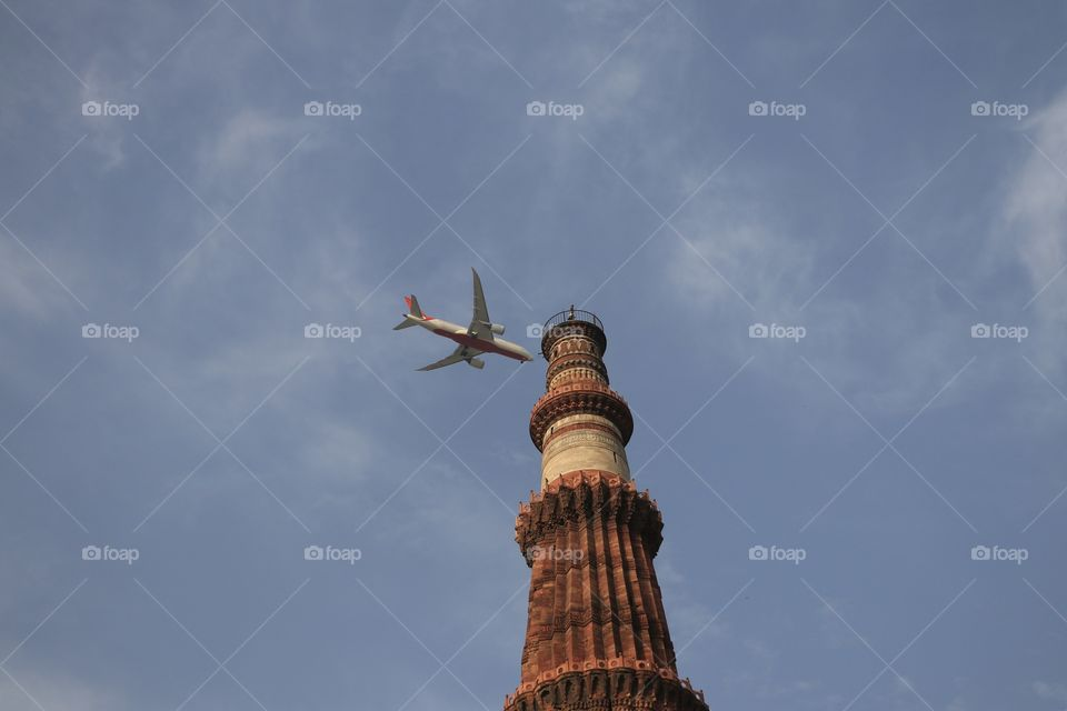 Landing on the tower. This is Qutab Minar in Delhi built in 11th century AD and it is world's tallest brick minaret. It is a UNESCO world heritage site.
