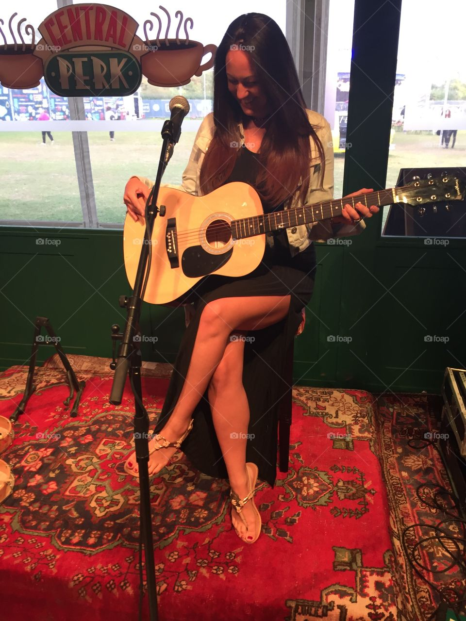 Friends recreation of phoebe playing guitar at central perk