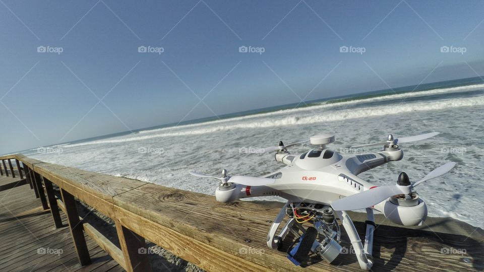 Drones, beach,  waves, photography and video.