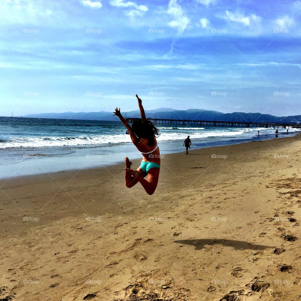 Jumping for Joy. Taken on Venice Beach in Los Angeles, CA