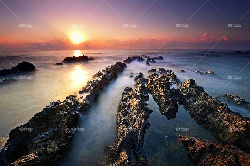 Beautiful sunset over the rocky beach in Terengganu, Malaysia