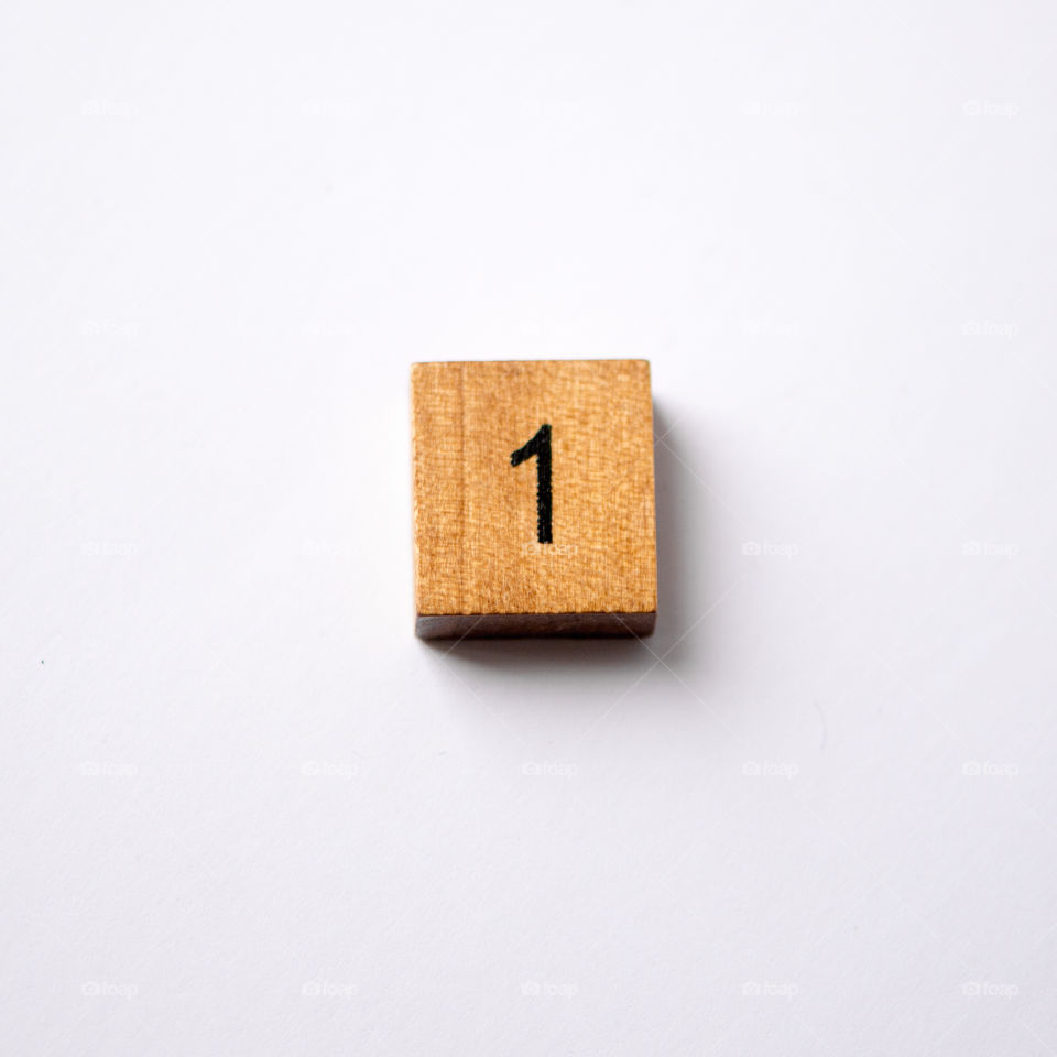 Wooden block Number one on white background