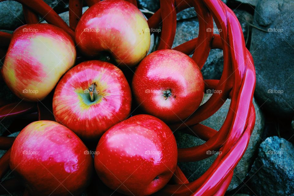 Ripe apples in basket