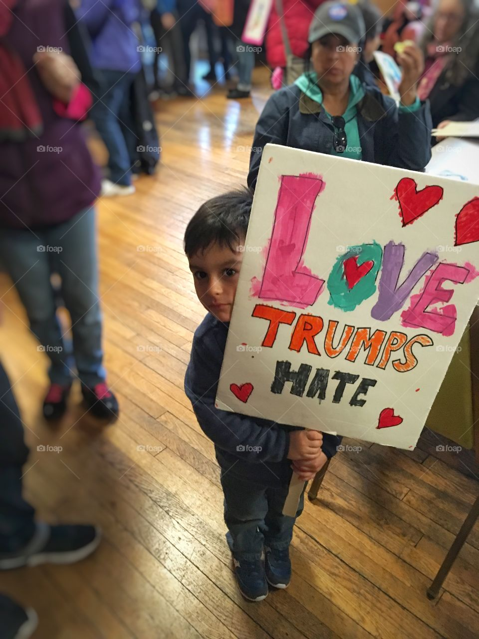 A little boy holding political supporter sign board
