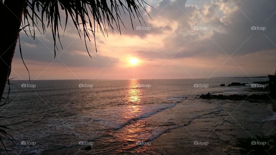 """Sunset in Bali. . A cliff side sunset in Bali Indonesia called """"Tanah Lot"""""""